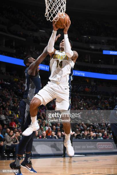 Gary Harris of the Denver Nuggets goes to the basket against the Detroit Pistons on March 15 2018 at the Pepsi Center in Denver Colorado NOTE TO USER...