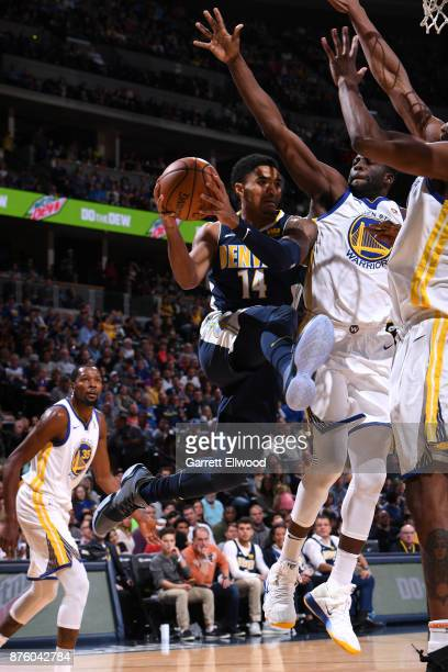 Gary Harris of the Denver Nuggets goes to the basket against the Golden State Warriors on November 4 2017 at the Pepsi Center in Denver Colorado NOTE...