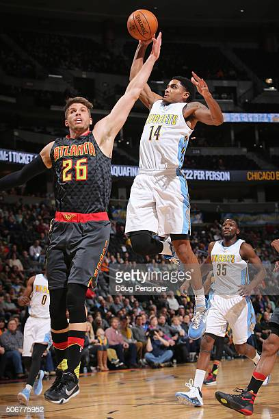 Gary Harris of the Denver Nuggets goes up to dunk the ball over Kyle Korver of the Atlanta Hawks at Pepsi Center on January 25 2016 in Denver...