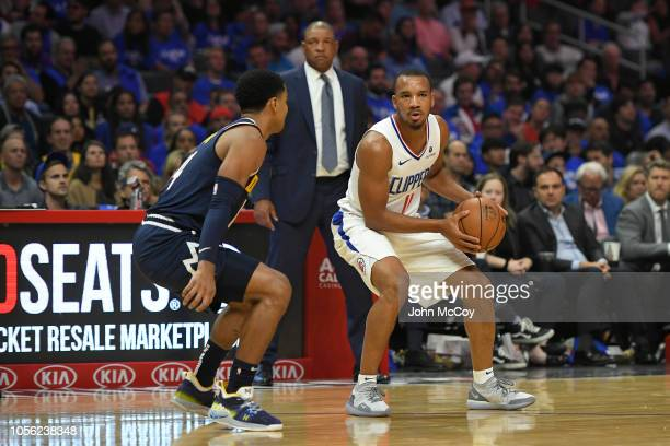 Gary Harris of the Denver Nuggets guards Avery Bradley of the Los Angeles Clippers during the season opening game at Staples Center on October 17,...
