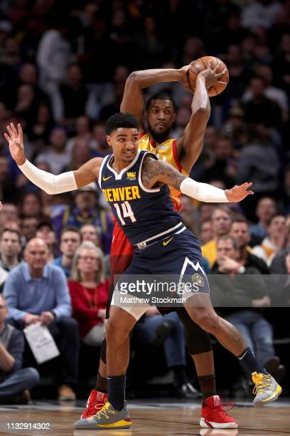 Gary Harris of the Denver Nuggets guards Derrick Flavors of the Utah Jazz in the first quarter at the Pepsi Center on February 28, 2019 in Denver,...