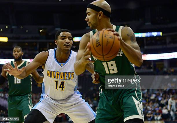 Gary Harris of the Denver Nuggets guards Jerryd Bayless of the Milwaukee Bucks during the third quarter at the Pepsi Center on November 11, 2015 in...