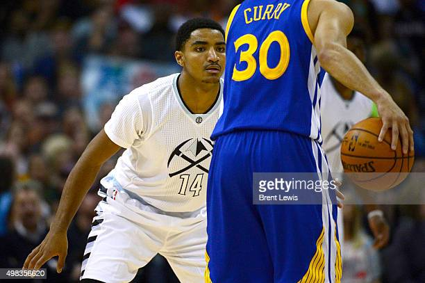 Gary Harris of the Denver Nuggets guards Stephen Curry of the Golden State Warriors during the second quarter at the Pepsi Center on November 22,...