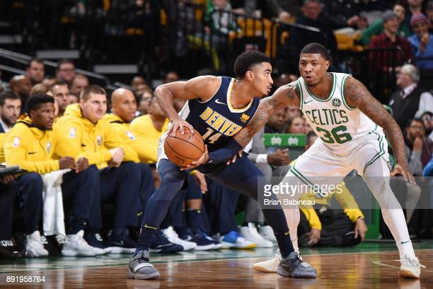 Gary Harris of the Denver Nuggets handles the ball against Marcus Smart of the Boston Celtics on December 13 2017 at the TD Garden in Boston...