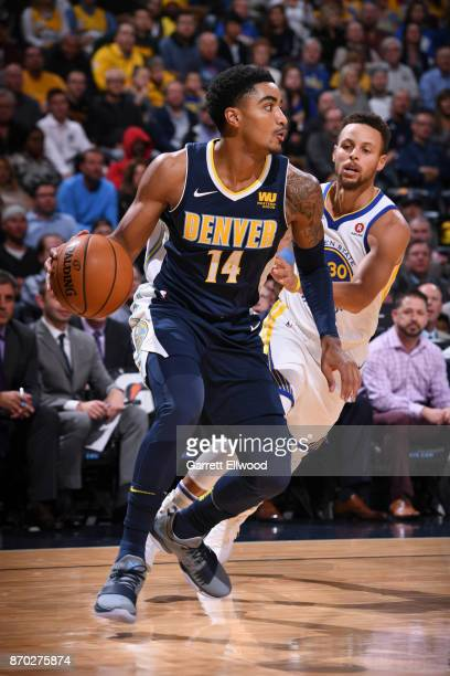 Gary Harris of the Denver Nuggets handles the ball against the Golden State Warriors on November 4 2017 at the Pepsi Center in Denver Colorado NOTE...
