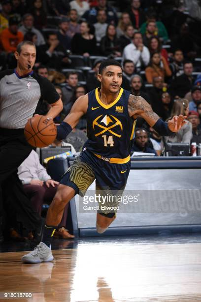 Gary Harris of the Denver Nuggets handles the ball against the San Antonio Spurs on February 13 2018 at the Pepsi Center in Denver Colorado NOTE TO...
