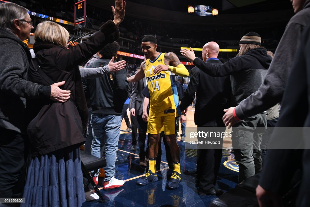 Gary Harris #14 of the Denver Nuggets high fives fans after the game against the Dallas Mavericks on January 27, 2018 at the Pepsi Center in Denver, Colorado.