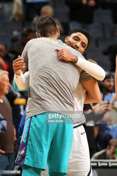Gary Harris of the Denver Nuggets hugs a player from the Charlotte Hornets after the game on March 5, 2020 at Spectrum Center in Charlotte, North...