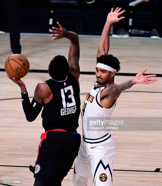 Gary Harris of the Denver Nuggets is called for a foul on Paul George of the LA Clippers during the third quarter in Game Seven of the Western...