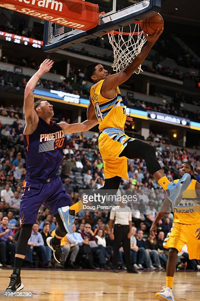 Gary Harris of the Denver Nuggets lays up a shot against Jon Leuer of the Phoenix Suns at Pepsi Center on November 20 2015 in Denver Colorado The...
