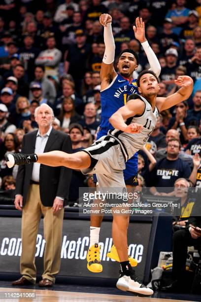 Gary Harris of the Denver Nuggets makes a three over Bryn Forbes of the San Antonio Spurs during the fourth quarter of the Spurs' 10195 win on...