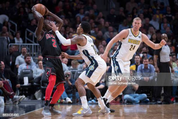 Gary Harris of the Denver Nuggets pressures Jerian Grant of the Chicago Bulls at Pepsi Center on November 30 2017 in Denver Colorado NOTE TO USER...