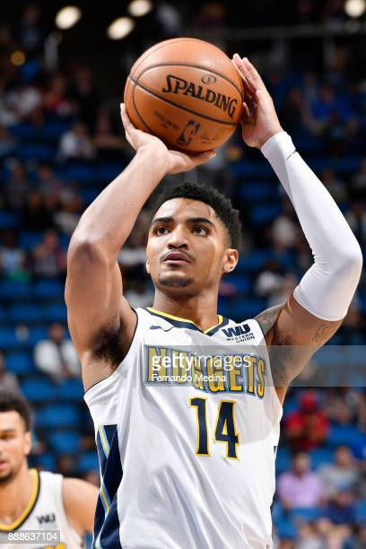 Gary Harris of the Denver Nuggets shoots the free throw against the Orlando Magic on December 8 2017 at the Amway Center in Orlando Florida NOTE TO...