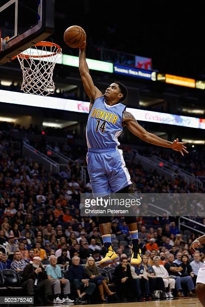 Gary Harris of the Denver Nuggets slam dunks the ball against the Phoenix Suns during the first half of the NBA game at Talking Stick Resort Arena on...
