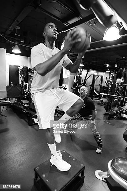 Gary Harris of the Denver Nuggets works out with Steve Hess before the game against the Utah Jazz on January 24 2017 at the Pepsi Center in Denver...
