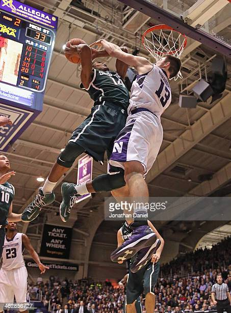Gary Harris of the Michigan State Spartans is fouled by Kale Abrahamson of the Northwestern Wildcats at WelshRyan Arena on January 15 2014 in...