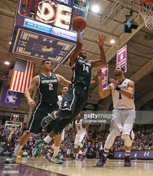 Gary Harris of the Michigan State Spartans puts up a shot against Drew Crawford of the Northwestern Wildcats at WelshRyan Arena on January 15 2014 in...