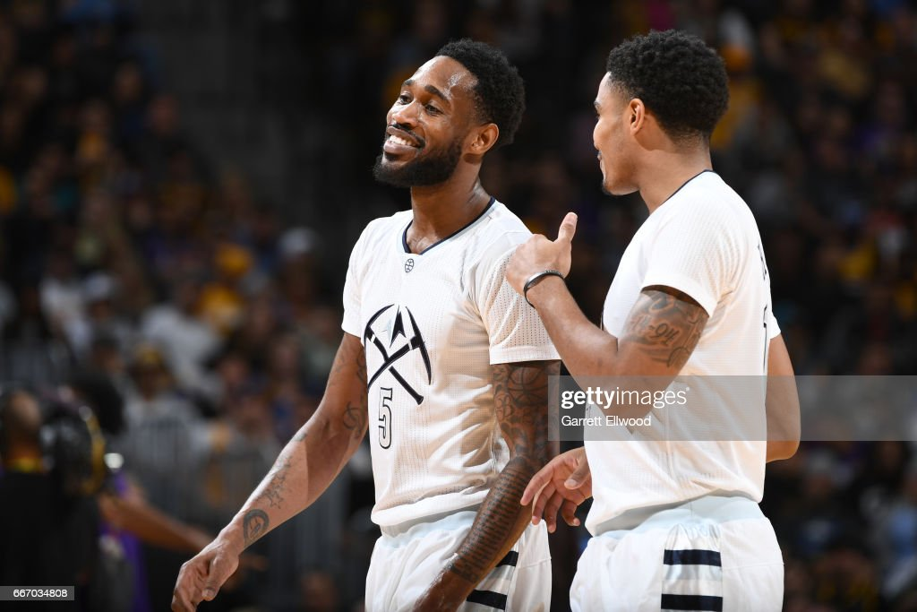 Gary Harris #14 talks with Will Barton #5 of the Denver Nuggets during the game against the Los Angeles Lakers on March 13, 2017 at the Pepsi Center in Denver, Colorado.