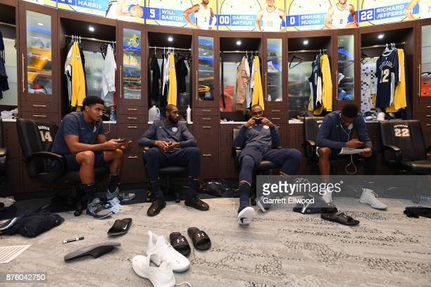 Gary Harris Will Barton Darrell Arthur and Emmanuel Mudiay of the Denver Nuggets in the locker room before the game against the Golden State Warriors...