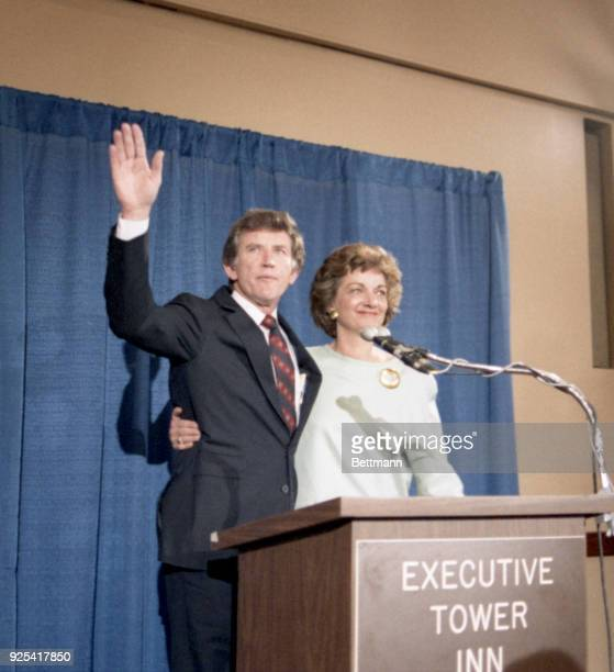 Gary Hart flanked by his wife Lee waves to his supporters as he enters the Executive tower Inn in Denver to withdraw from the running for the...