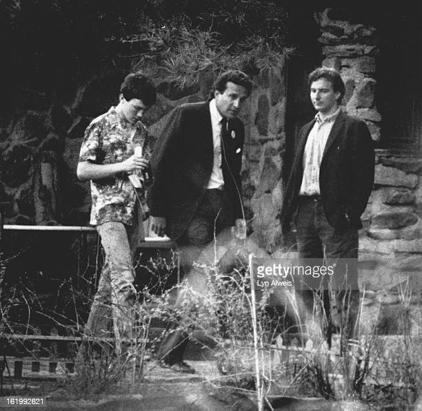 Gary Hart - Personal; Youngster who ran up and took the Hart's picture with his instamatic is escorted off the grounds by campaign personell.; Kid is...