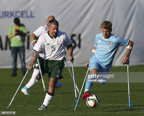 Gary Hoey of Ireland in action against Jamie Tregaskiss of England during the European Amputee Football Federation European Championship match...