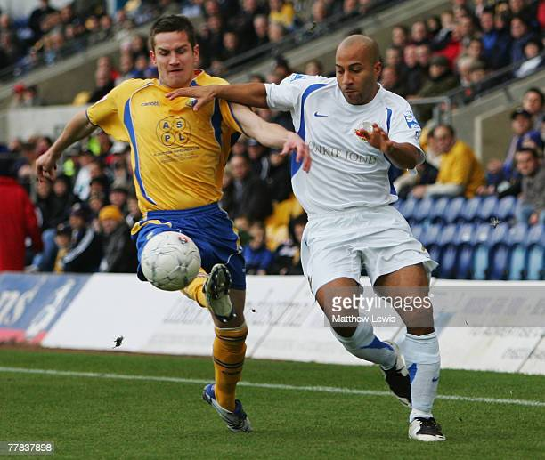 Gary Holloway of Lewes and Lee Bell of Mansfield challenge for the ball during the FA Cup sponsored by Eon First Round match between Mansfield Town...
