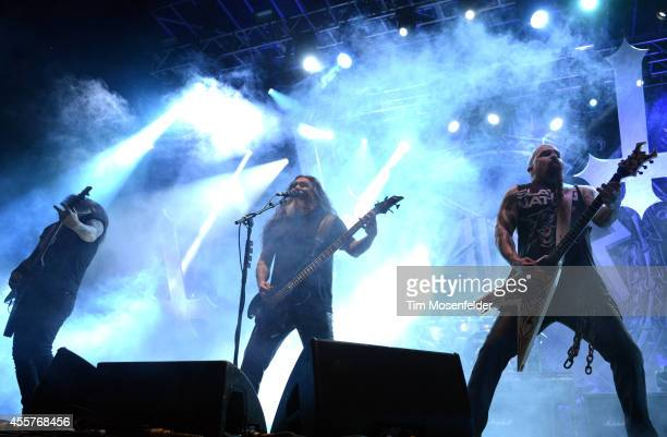 Gary Holt Tom Araya and Kerry King of Slayer perform during the Riot Fest Music Festival at Sports Authority Field at Mile High on September 19 2014...