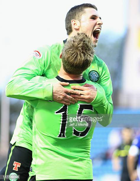 Gary Hooper of Celtic celebrates with Kris Common after scoring during the Clydesdale Bank Premier League match between Kilmarnock and Celtic at...