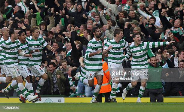 Gary Hooper of Celtic celebrates with team mates after scoring the first goal during the Clydesdale Bank Premier League match between Celtic and...