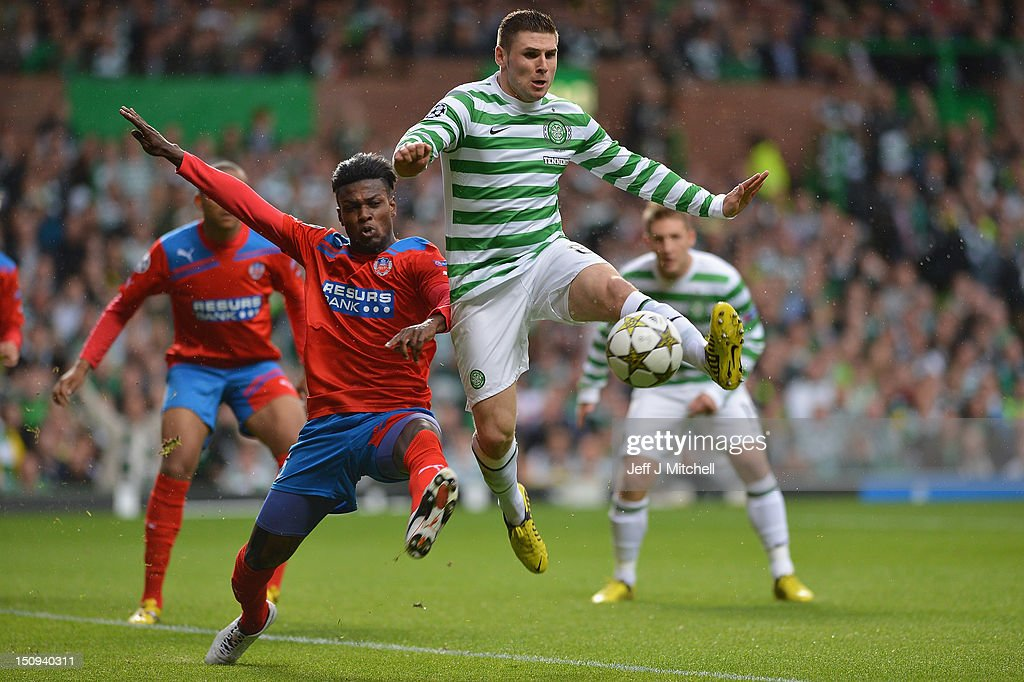 Gary Hooper of Celtic competes with May Mahlangu of Helsingborgs IF during the UEFA Champions League Play Off Round between Celtic and Helsingborgs IF at Celtic Park on August 29, 2012 in Glasgow, Scotland.