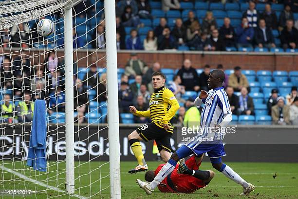 Gary Hooper of Celtic scores during the Scottish Clydesdale Bank Scottish Premier League match between Kilmarnock and Celtic at Rugby Park on April 7...
