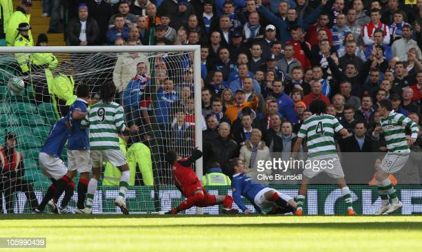 Gary Hooper of Celtic scores the first goal during the Clydesdale Bank Premier League match between Celtic and Rangers at Celtic Park on October 24...