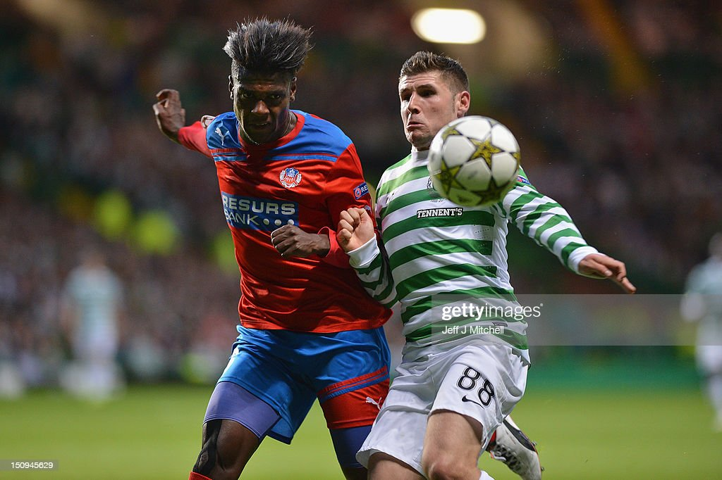 Gary Hooper of Celtic tackles May Mahlangu of Helsingborgs IF during the UEFA Champions League Play Off Round between Celtic and Helsingborgs IF at Celtic Park on August 29, 2012 in Glasgow, Scotland.