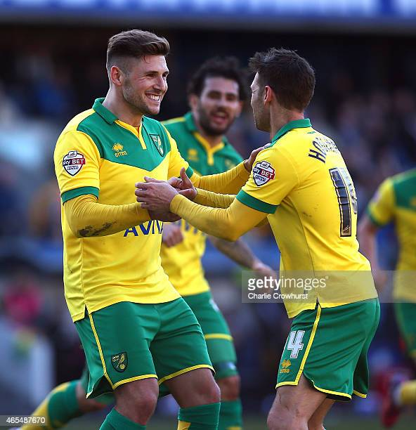 Gary Hooper of Norwich celebrates with team mate Wes Hoolahan after he scores teams second goal of the game during the Sky Bet Championship match...