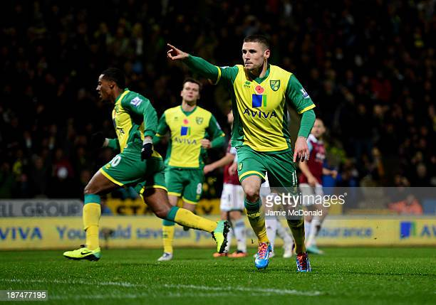 Gary Hooper of Norwich City celebrates as he scores their first goal from the penalty spot during the Barclays Premier League match between Norwich...