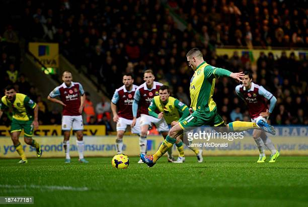 Gary Hooper of Norwich City scores their first goal from the penalty spot during the Barclays Premier League match between Norwich City and West Ham...