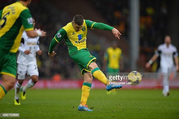 Gary Hooper of Norwich scores their fisrt goal during the Barclays Premier League match between Norwich City and Swansea City at Carrow Road on...
