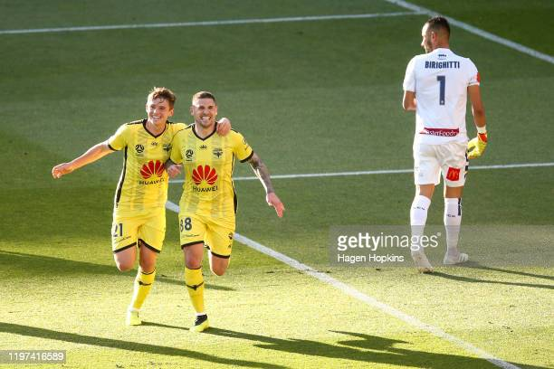Gary Hooper of the Phoenix celebrates with Callum McCowatt after scoring a goal during the round 13 A-League match between the Wellington Phoenix and...