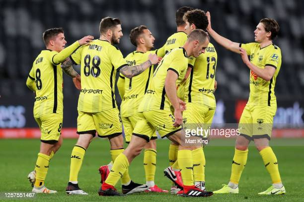 Gary Hooper of the Phoenix celebrates with team mates after scoring a goal during the round 27 A-League match between the Perth Glory and the...