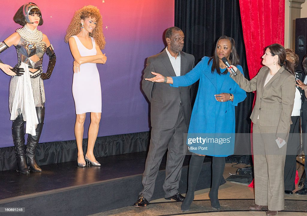 Gary Houston (L) and Pat Houston (C) attend Madame Tussauds Whitney Houston Wax Unveiling at Madame Tussauds on February 7, 2013 in New York City.