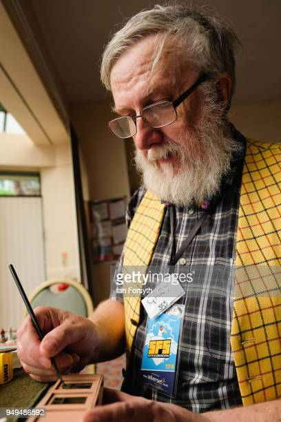 Gary Hughs from Scarborough Gaming Society paints a model house during the Scarborough Sci-Fi event held at the seafront Spa Complex on April 21,...
