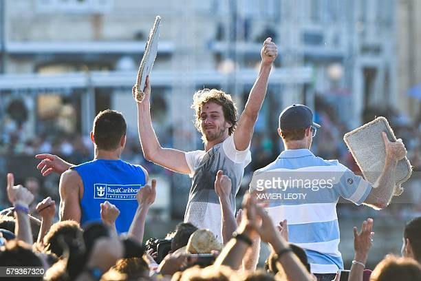 Gary Hunt from Britain celebrates after winning the Red Bull Cliff Diving World Series on July 23 2016 in La Rochelle southwestern France / AFP /...