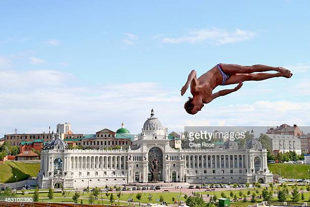 Gary Hunt of Great Britain competes in the Men's 27m High Diving Final on day twelve of the 16th FINA World Championships at the Kanzanka River on...