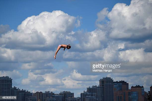 Gary Hunt of Great Britain competes in the Men's High Diving 27m preliminary round on day ten of the 16th FINA World Championships at the Kazanka...
