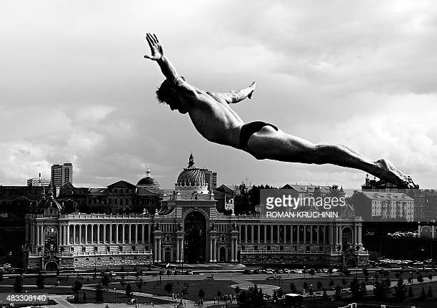 Gary Hunt of Great Britain competes to win the Men's 27m High Diving Final during the 16th FINA World Championships at the Kanzanka River on August 5...