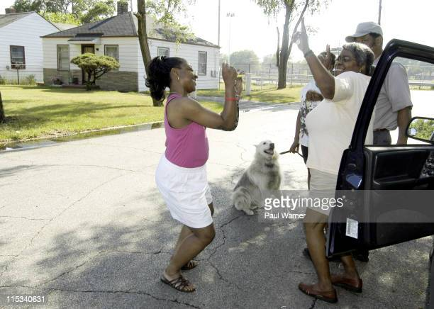 Gary Indiana residents Debra Cooper left and Janine Bray dance at the corner of 23rd and Jackson St in front of the house that the Jackson family...