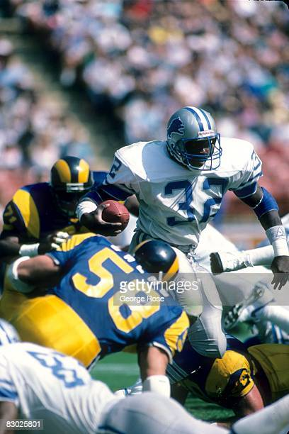 Gary James of the Detroit Lions runs the ball against the Los Angeles Rams during a game at Anaheim Stadium on October 19 1986 in Anaheim California...