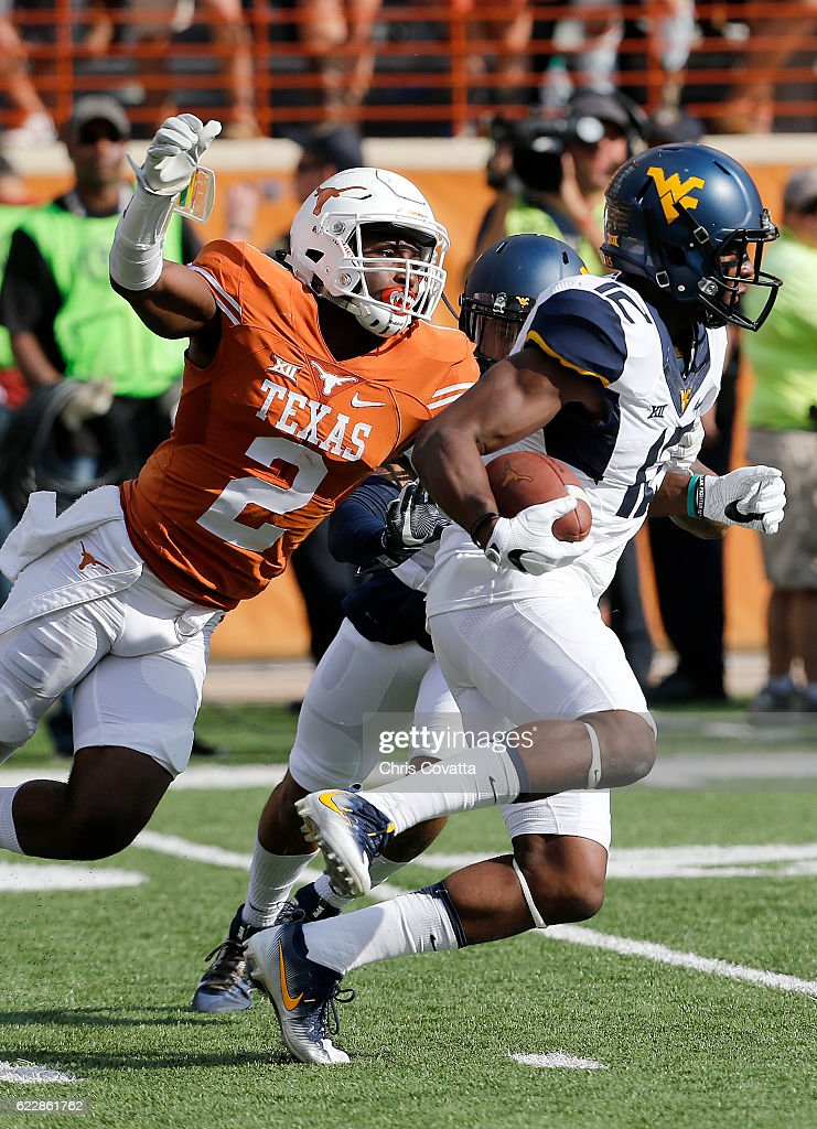 Gary Jennings #12 of the West Virginia Mountaineers runs with the ball as Kris Boyd #2 of the Texas Longhorns attempts to stop him at Darrell K Royal -Texas Memorial Stadium on November 12, 2016 in Austin. Texas.