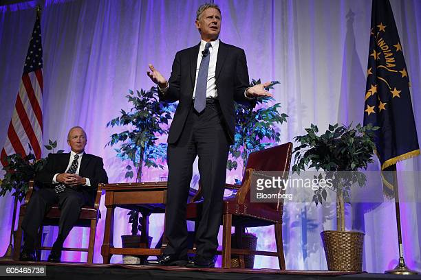 Gary Johnson, 2016 Libertarian presidential nominee, center, speaks as Mitch Daniels, president of Purdue University and former governor of Indiana,...